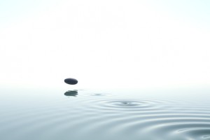 zen stone thrown on the water